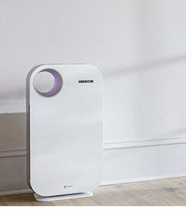 Air purifier in clean, sunlit room